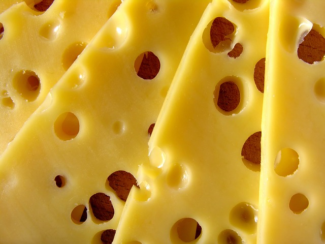 four slices of swiss cheese