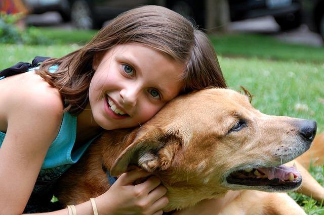 girl bonding with dog